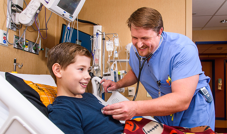 Dr. Nathan Beckett with pediatric patient