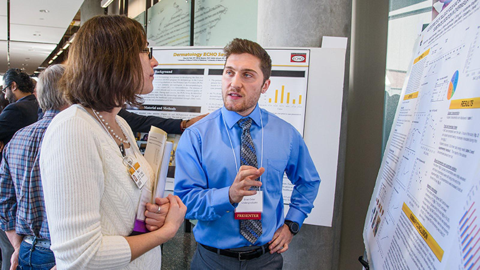 Photo of student presenting at conference.