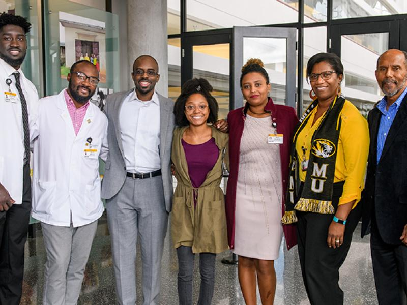 Dale Okorodudu, MD '10, third from left, is joined by MU medical students