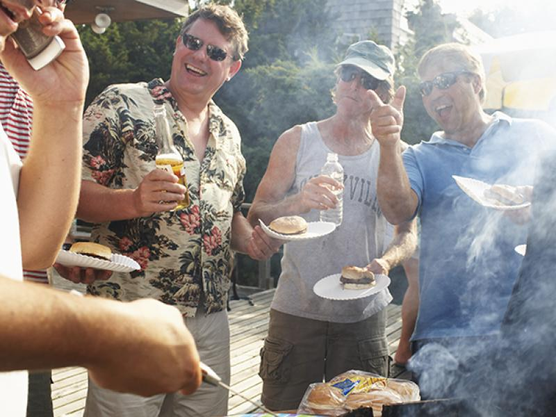 a bbq with burgers and beer