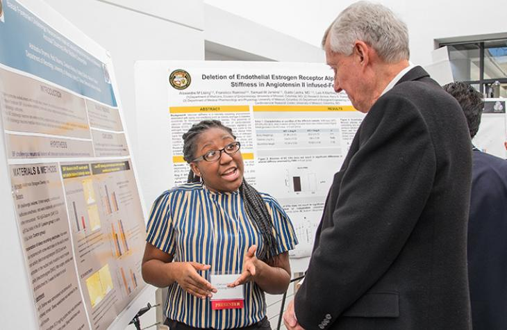Photo of student and professor at Health Sciences Research Day.